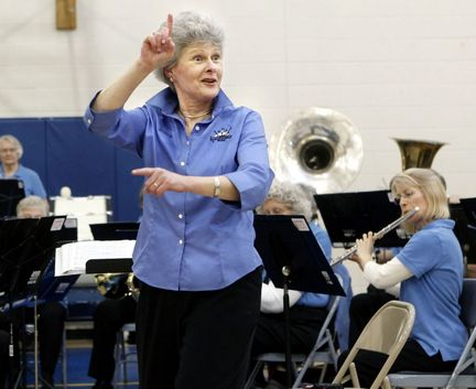 "New Horizons Band Director Nancy Summers-Meeusen gestures to an audience at the Salvation Army while directing on Friday, March 19. ""The people are great and there is such enthusiasm...you can feel it,"" Summers-Meeusen said about New Horizons. The program is for older adults who are taking up a musical instrument for the first time or who are coming back to it after many years. ""Our motto is music for life,"" Summers-Meeusen said, ""and that pretty much sums it up.""  (Emily Zoladz 